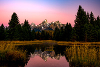 Dawn at The Grand Tetons as viewed in autumn from Schwabacher Landing, Grand Teton National Park