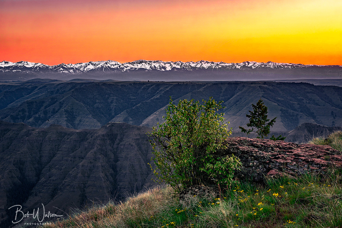Imnaha River Valley, Oregon. with Seven Devil Mountains, Idaho, at sunset.